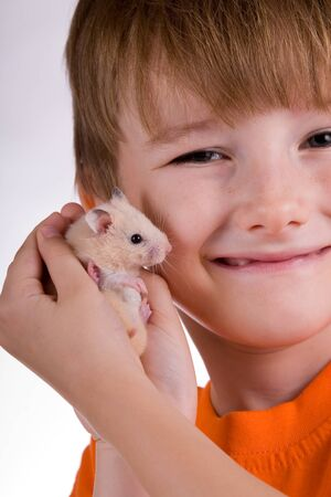 Boy with a hamster on a white background Stock Photo