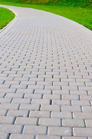 pavers: Garden stone path with grass growing around stones Stock Photo
