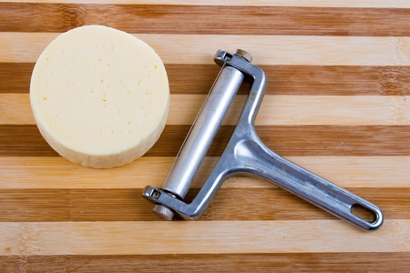 Round cheese on a wooden board Stock Photo - 11009244