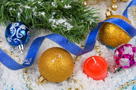 Christmas decorations in the snow on a blue background photo