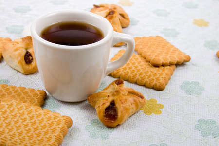 Cup of tea and biscuits on the table photo