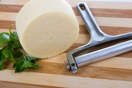 Round cheese on a wooden board Stock Photo - 11265119