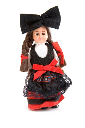 Doll in the French national costume on a white background photo