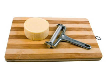 Round cheese on a wooden board Stock Photo - 11704558