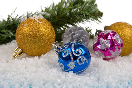 Christmas decorations in the snow on a white background photo