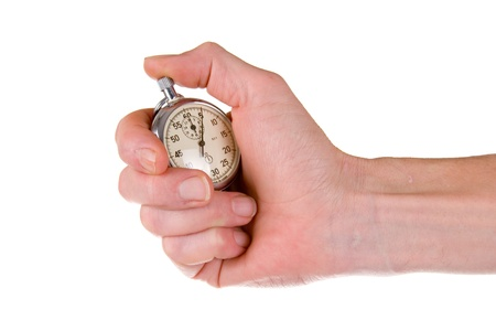 Man's hand holding stopwatch, isolated on a white background.  Фото со стока