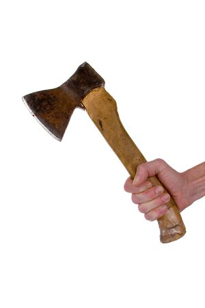 Axe with wooden handle in a mans hand photo