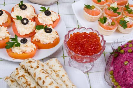 maslenitsa: Pancakes with red caviar on a plate.The celebration of Maslenitsa - Russian religious and folk holiday.