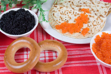 Pancakes with red and black caviar.The celebration of Maslenitsa - Russian religious and folk holiday. photo
