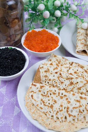 Pancakes with red and black caviar.The celebration of Maslenitsa - Russian religious and folk holiday. Stock Photo - 12065590