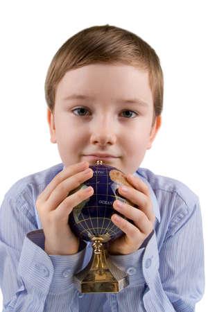 Boy holding globe, isolated on a white background photo