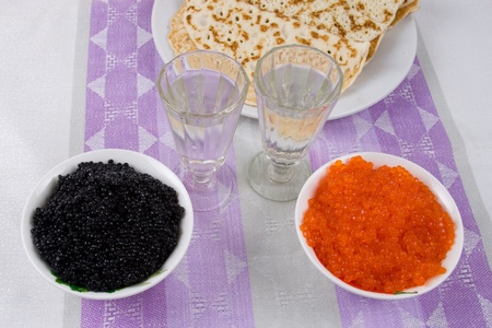baranka: Vodka, pancakes, red and black caviar on a table Stock Photo