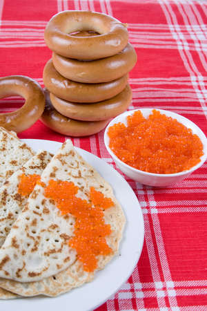 Pancakes with red caviar.The celebration of Maslenitsa - Russian religious and folk holiday. photo