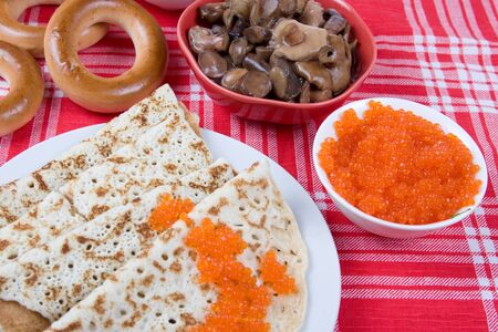 Pancakes with red  caviar.The celebration of Maslenitsa - Russian religious and folk holiday. Stock Photo - 12362678