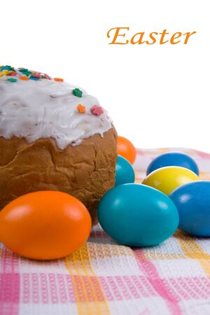Easter eggs and cake on the bright checkered tablecloth Stock Photo - 12357310