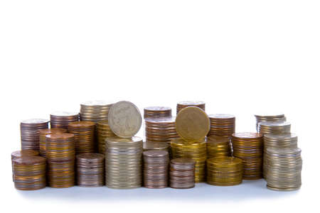Towers from coins isolated on a white background Stock Photo - 12362691