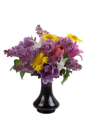 Bouquet of spring flowers in a vase on a white background Stock Photo - 12918571