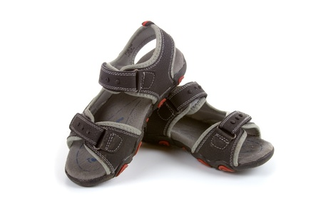 Childrens sandals on a white background  photo