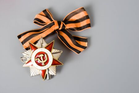 Order of the Patriotic War and St. Georges Ribbon  on a gray background  photo