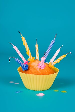 blow out: Festive cupcake with a blow out candles on gradient background