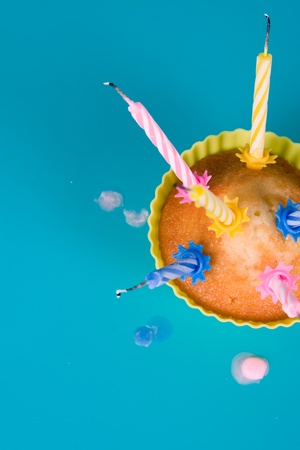 blow out: Festive cupcake with a blow out candles  Stock Photo