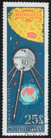 MONGOLIA - CIRCA 1976  A stamp printed in Mongolia shows satellite Lunik 2, circa 1976  Stock Photo - 13436980