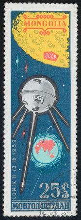 MONGOLIA - CIRCA 1976  A stamp printed in Mongolia shows satellite Lunik 2, circa 1976  Stock Photo - 13436980
