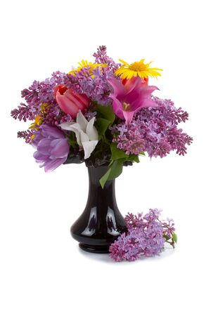 Bouquet of spring flowers in a vase on a white background photo
