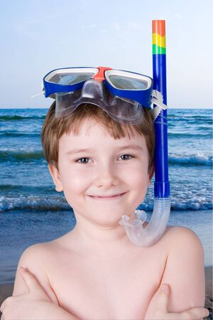 Boy in swimming mask against the sea