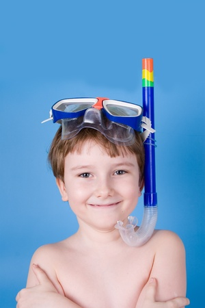 Boy in swimming mask on a blue background photo