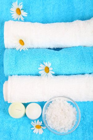 Beautiful spa setting with daisies, salt and towels photo