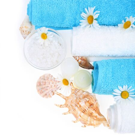 Spa still life with sea salt, shells, daisies and towels photo