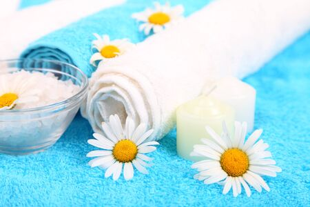 Spa still life with towels, flowers and salt  photo