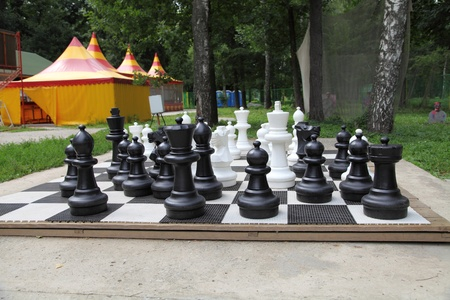 Outdoor chess board with big plastic pieces  photo