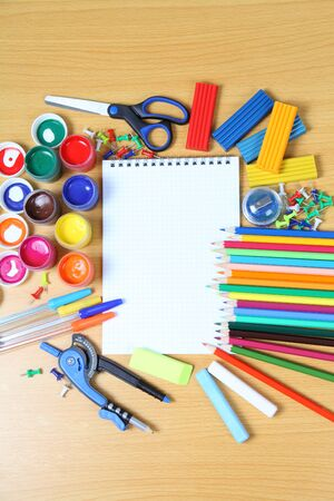 School accessories on a wooden table  photo