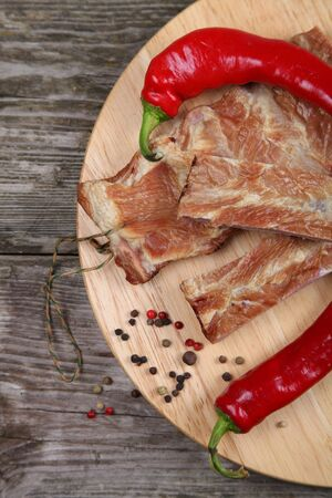 Smoked pork ribs on a wooden board photo