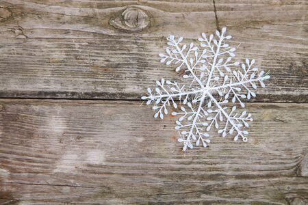 Christmas decorations (snowflake) on a wooden background  Stock Photo