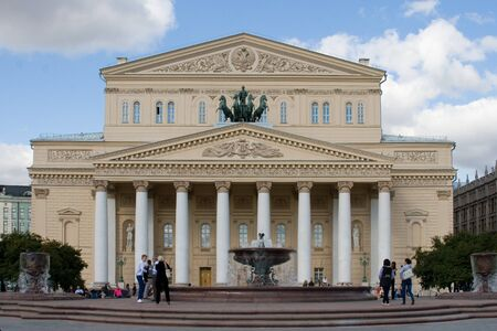 bove: MOSCOW, RUSSIA - SEPTEMBR 17: People before Grand Theatre in September 17, 2012 in Moscow, Russia. Grand Theatre (Bolshoi Theater) is one of the most famous theaters in the world