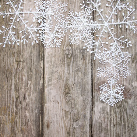 Christmas snowflakes, on a wooden background Stock Photo - 15629724
