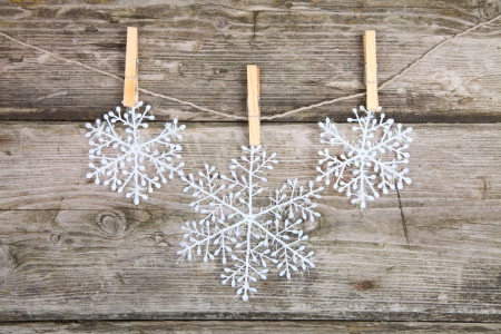 Christmas decorations, snowflakes hanging over wooden background Stock Photo - 15629794