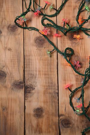 christmas illuminations: Christmas lights on a wooden background with copy space. Decorative garland  Stock Photo