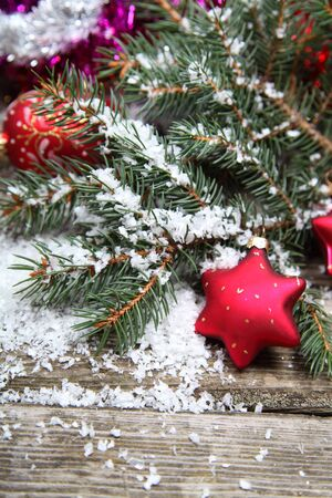 Red Christmas decoration on spruce branches with snow Stock Photo - 15629730