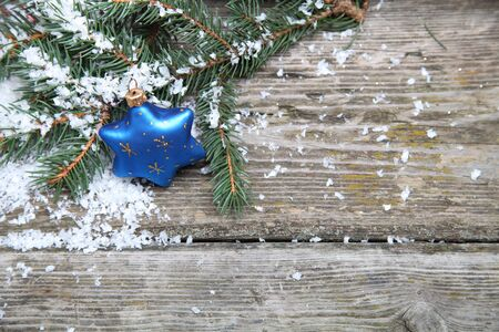 Blue Christmas decorations on a wooden background photo