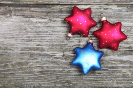 Christmas decorations. Stars on a wooden background photo