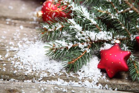 Red Christmas decoration on spruce branches with snow Stock Photo