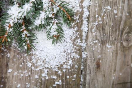 Fir branches in the snow on a wooden background Stock Photo - 15724685