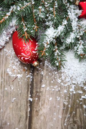 Red Christmas decoration on spruce branches with snow Stock Photo - 15724690