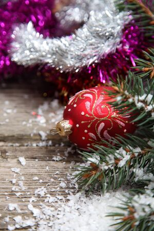 Red Christmas decorations on spruce branches with snow Stock Photo - 15843543