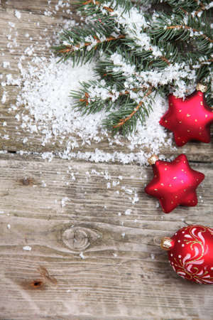 Red Christmas decorations on spruce branches with snow Stock Photo - 15843499