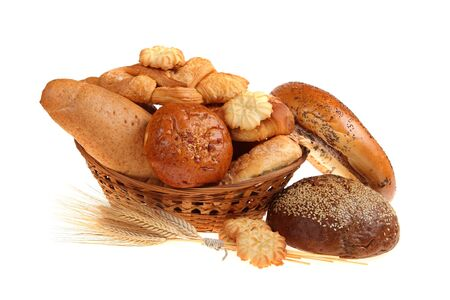 Bread in a basket, isolated on white background photo
